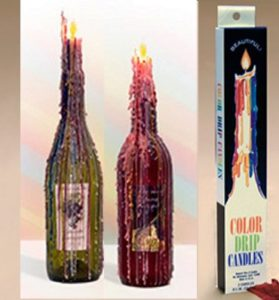 colorful drip taper candles used on wine bottle